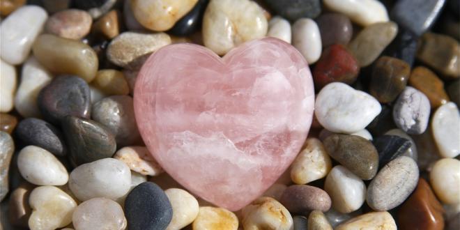 a pebble rock garden with a rose quartz heart